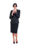 Full body of business woman drinking healthy juice Stock Photography