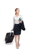 Full body business woman traveling with suitcase and holding pas Stock Photos