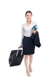 Full body business woman traveling with suitcase and holding pas stock photo