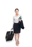 Full body business woman traveling with suitcase and holding pas Stock Images