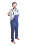 Full body of cheerful mechanic with spanner showing thumbup Stock Photos