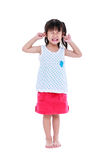Full body of child putting finger on her ears. Isolated on white. Full body of child putting finger on her ears. Asian girl an attitude ignoring parents scolding Stock Photography