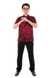 Full body Chinese cheongsam male respecting Royalty Free Stock Image