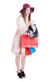 Full body of curious young shopaholic carrying shopping bags Stock Photography