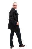 Full body of elegant man posing holding overcoat Stock Image