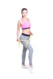Full body of female measuring her leg Stock Photos