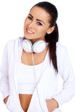 Full body of a female relaxing with music. On her headphones and digital player Stock Image