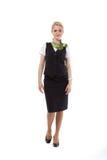 Full body flight attendant standing Stock Photography