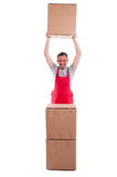 Full body guy lifting or holding up cardboard box. And smiling isolated on white background Royalty Free Stock Image
