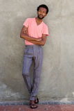 Full body handsome african american man standing with arms crossed Royalty Free Stock Photos