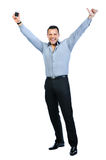 Full body of happy gesturing young smiling business man. With mobile phone, isolated over white background Royalty Free Stock Photo