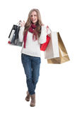 Full body of a happy shopping female Royalty Free Stock Photos