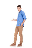 Full body image of a young casul man presenting Royalty Free Stock Image