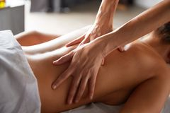 Full body massage in spa salon royalty free stock photo