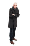 Full body of middle age man wearing raincoat. With arms crossed looking cold isolated on white background Royalty Free Stock Photography