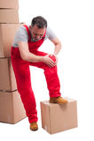 Full body of mover guy holding his knee like hurting Stock Photography