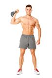 Full body of muscular man exercising with dumbbell on white. Background stock photography