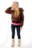 Full Body Of Young Model Listening Music Stock Images