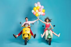 Full body photo of crazy two people lady guy drive retro moped travelers spread legs raise arms many air balloons