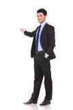 Full body picture of a businessman presenting Stock Photo