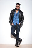 Full body picture of a casual man in leather jacket Stock Images
