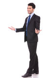 Full body picture of an excited businessman welcoming Stock Photography