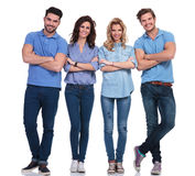 Full body picture of four casual young smiling people Stock Image