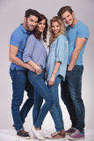 Full body picture of four  happy casual people standing together Royalty Free Stock Photography