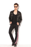 Full body picture of a  man in leather jacket and sunglasses Royalty Free Stock Images