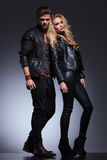 Full body picture of a man and woman in leather clothes Royalty Free Stock Images