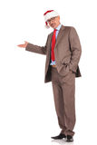 Full body picture of an old santa claus businessman presenting Royalty Free Stock Images