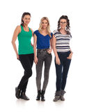 Full body picture of three casual young women posing together Royalty Free Stock Photography