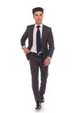 Full body picture of a young business man walking Stock Photography