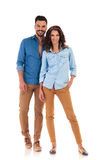 Full body picture of young casual couple standing and smiling. Together on white background Royalty Free Stock Images