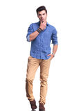 Full body picture of a young casual man thinking Royalty Free Stock Photography