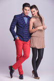 Full body picture of a young fashion couple posing Stock Images