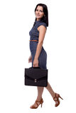 Full body portrait of business woman in dress with portfolio, briefcase, isolated on white Stock Photo
