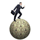 Full body portrait of a businessman on a globe made of money Stock Images