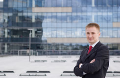 Full body portrait of a casual business man. Standing outdoor the office Stock Photo