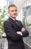 Full body portrait of a casual business man. Standing outdoor the office Royalty Free Stock Photo