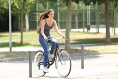 Full body portrait of a cyclist riding in the street. Full body portrait of a happy cyclist riding a bicycle in the street royalty free stock photos