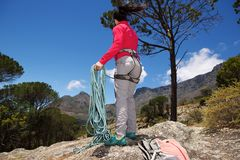 Full body female hiker rope standing on the rock over the mountain Royalty Free Stock Photography