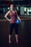 Full body portrait of fit woman in fitness studio Stock Photography