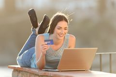 Online buyer is paying with credit card and laptop stock photos