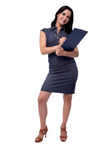 Full body portrait of smiling business woman in dress writes with clipboard and pen, isolated on white Stock Photography