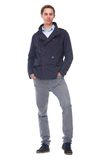 Full body portrait of a trendy young man in blue jacket Royalty Free Stock Photos