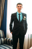 Full body portrait of young stylish businessman in tie and vest with hands on waist Stock Images