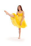 Full body portrait of young woman in yellow dress. White background Stock Photo