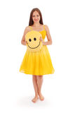 Full body portrait of young woman in yellow dress. White background Stock Images