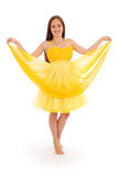Full body portrait of young woman in yellow dress. White background Royalty Free Stock Images